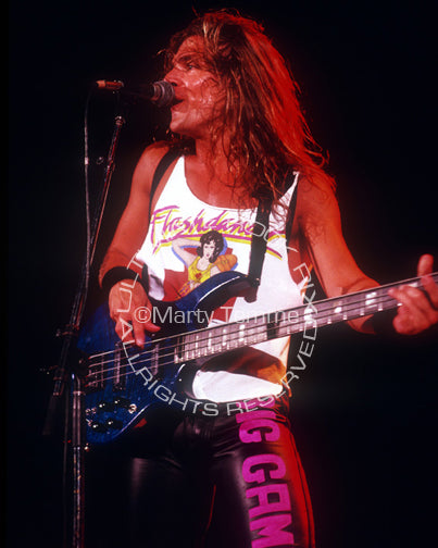Photo of bass player James LoMenzo of White Lion in concert in 1989 by Marty Temme