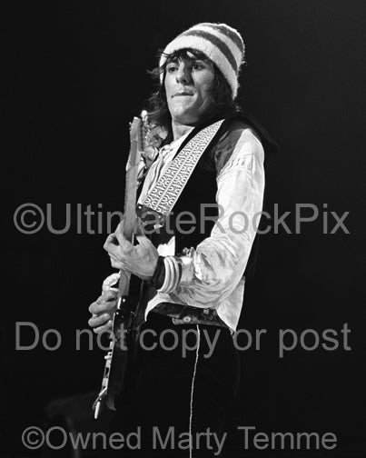 Photo of guitarist Ron Wood of The Faces playing a Fender Stratocaster in concert in 1973 by Marty Temme