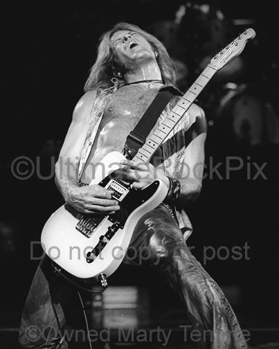 Black and white photo of Doug Aldrich playing a Fender Telecaster - wsdabw031