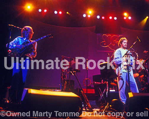 Photo of Steve Howe and Jon Anderson of Yes in concert in 2003 by Marty Temme