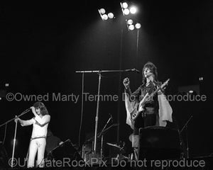 Black and white photo of Jon Anderson and Chris Squire of Yes in concert in the 1970's by Marty Temme