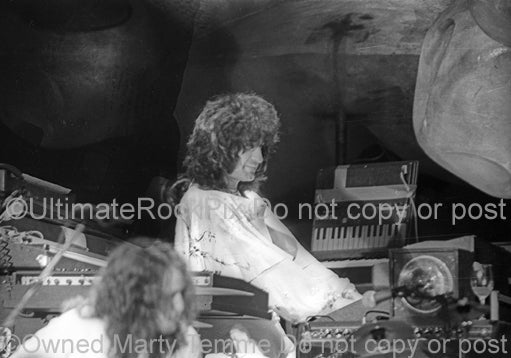 Photo of keyboardist Patrick Moraz of Yes in concert in 1975 by Marty Temme