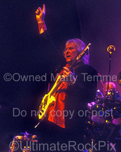 Photo of Chris Squire of Yes playing a Rickenbacker bass in concert by Marty Temme