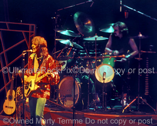 Photo of Chris Squire and Alan White of Yes in concert in 1977 by Marty Temme