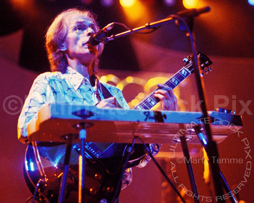 Photo of guitarist Steve Howe of Yes playing a pedal steel guitar in concert by Marty Temme