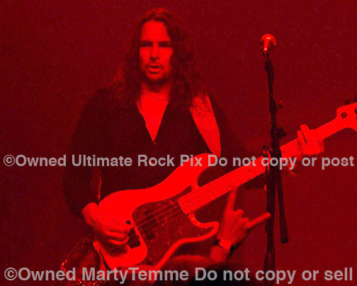 Photo of bassist Bjorn Englen of Yngwie Malmsteen in concert in 2008 by Marty Temme