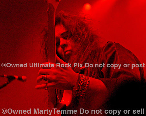 Photo of Yngwie Malmsteen in concert in 2008 by Marty Temme