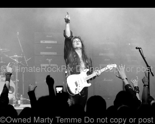 Black and white photo of Yngwie Malmsteen onstage in 2008 by Marty Temme