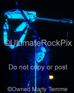 Photo of guitarist Yngwie Malmsteen in concert in 1994 by Marty Temme