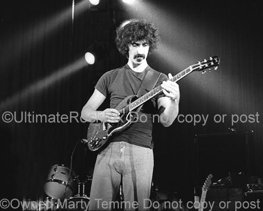 Photos of Guitarist Frank Zappa Playing a Gibson SG Special in 1973 by Marty Temme