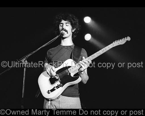 Photos of Guitarist Frank Zappa Playing a Fender Telecaster in 1973 by Marty Temme