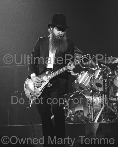 Photo of guitarist Billy Gibbons of ZZ Top playing a Gibson Les Paul onstage in 1979 by Marty Temme