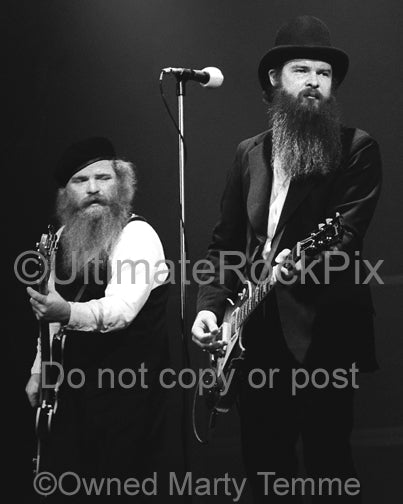 Photo of Billy Gibbons and Dusty Hill of ZZ Top in concert in 1979 by Marty Temme