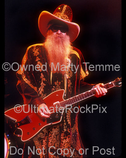 Photo of Billy Gibbons of ZZ Top playing a Gretsch Billy-Bo Jupiter Thunderbird in concert in 2003 by Marty Temme