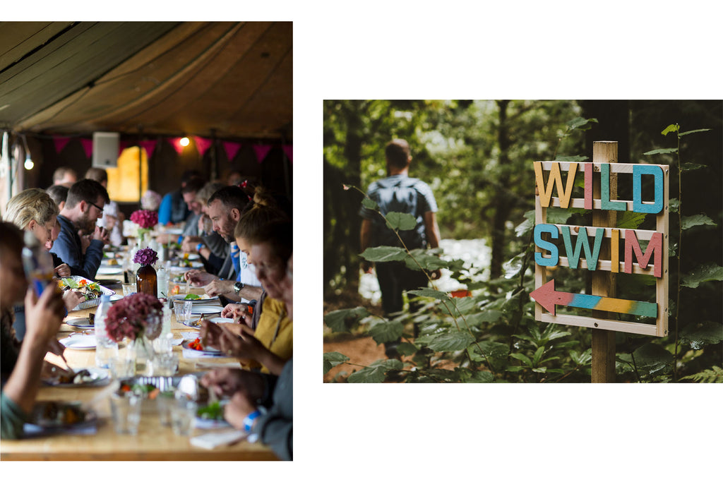 People eating and wooden wild swim sign at The Goodlife Experience