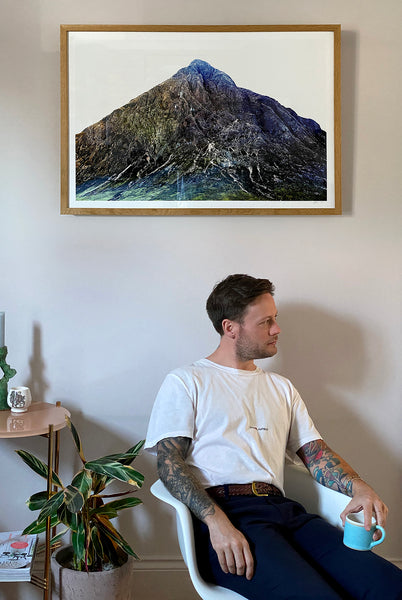 Lee sitting at home wearing his Braided Walnut Brown Awling belt.