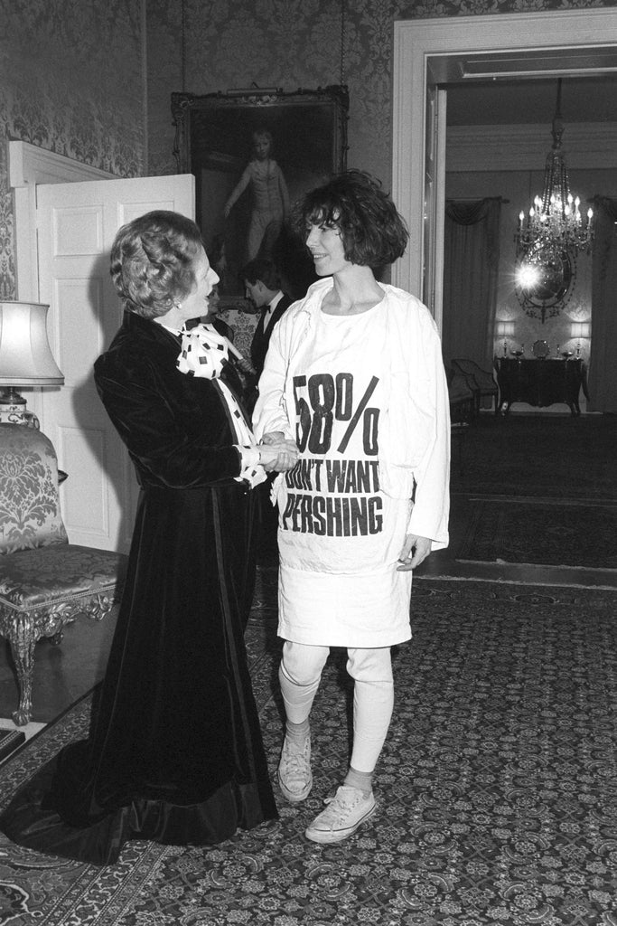 """Katharine Hamnett in a slogan Tshirt saying """"58% DON'T WANT PERSHING"""" at a reception in 1984 meeting Margaret Thatcher"""