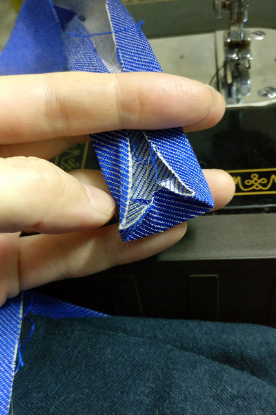 fold the end of the tape and stitch