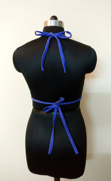 tie the strap at the back (halter neck type)
