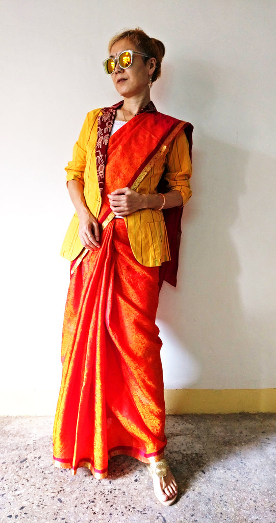 Festival outfit with a orange South silk saree and MIRCHI KOMACHI cotton yellow blazer jacket