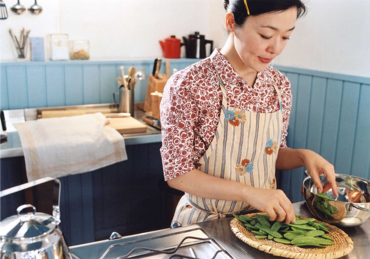 image of Sachie cooking in Kamome Diner - still from the film Kamome Shokudo