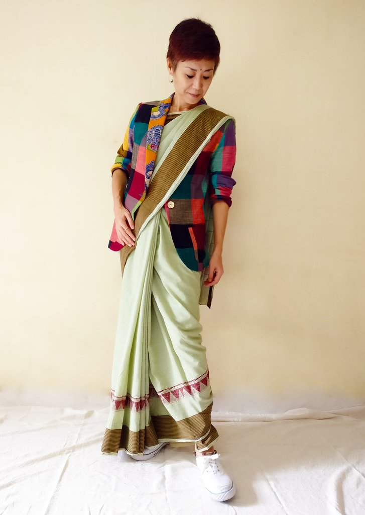 Image of MIRCHI KOMACHI designer cum patternmaker wearing a saree with a blazer jacket