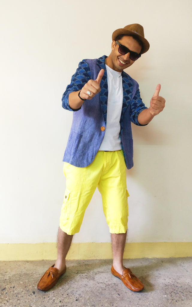 Saurabh Sharma in MIRCHI KOMACHI Men's Blazer Jacket - Jute Linen Mix & Ajrakh with a white tshirt, yellow short pants, brown moccasin, and brown fedora hat