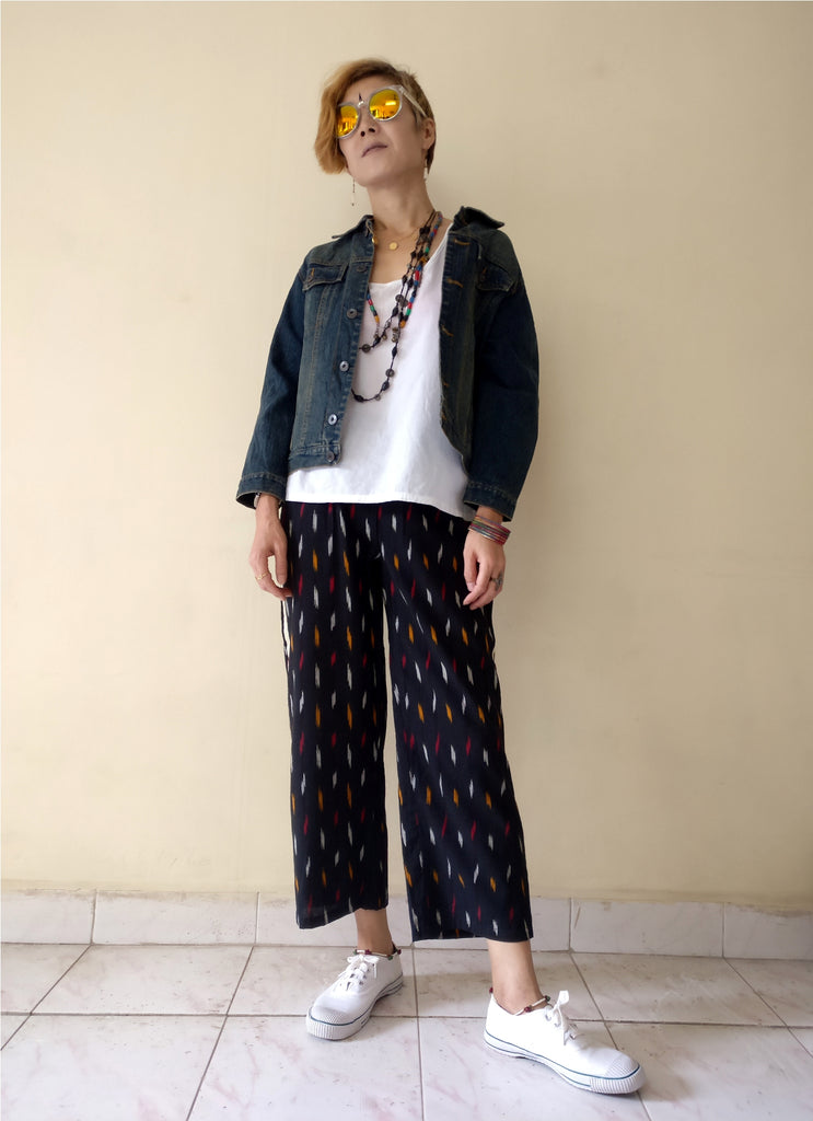 "3rd image for a blog ""7 Ways How to Style Track Pants - Let's Create India's Answer"", Ikat track pants with a denim jacket"