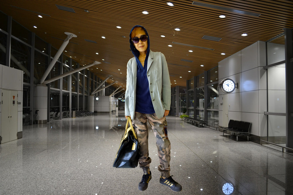 image of an airport outfit idea with hooded t-shirt, oversized blazer, and a military cargo pants