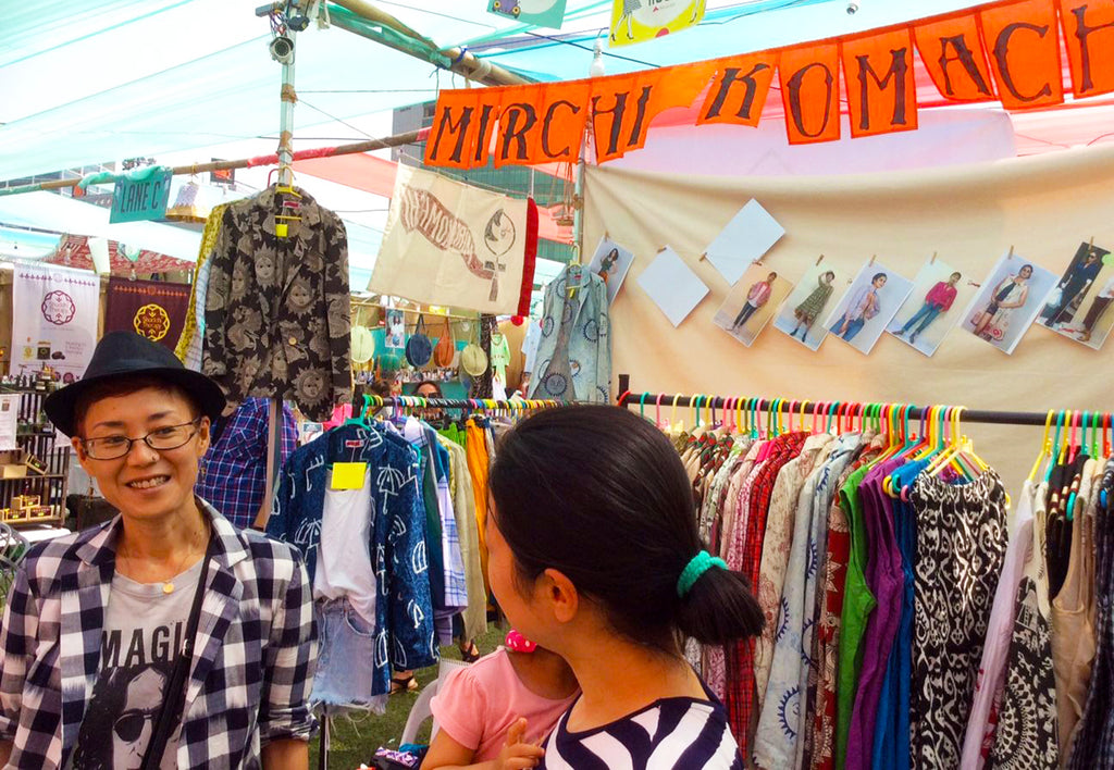 Image of Yoshiko, designer cum pattern maker of MIRCHI KOMACHI, with a customer in front of MIRCHI KOMACHI stall at The Lil Flea at Jio Garden, Bandra