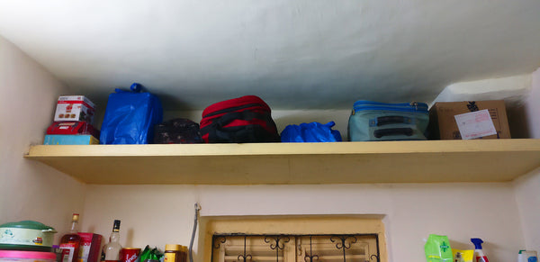 "my guy's ""up there"" things after Konmari"