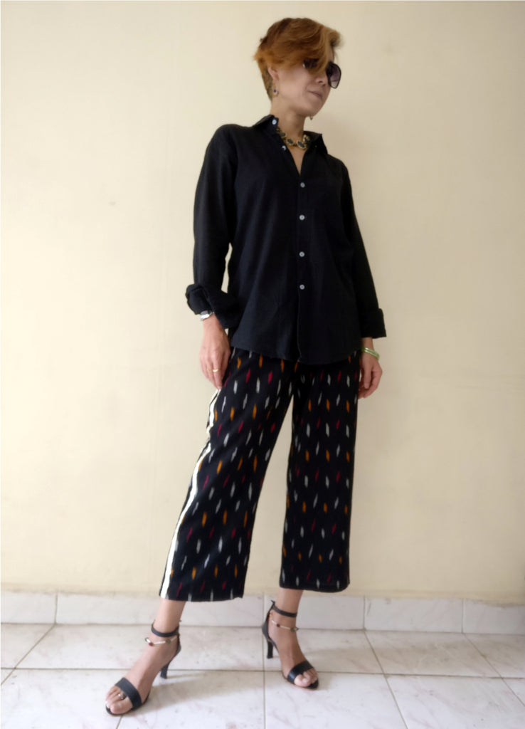 "4th image for a blog ""7 Ways How to Style Track Pants - Let's Create India's Answer"", Ikat track pants with a black mens shirt"