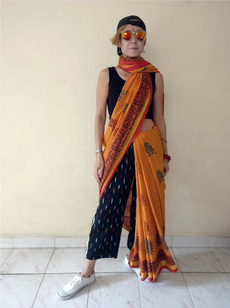 "7th image for a blog ""7 Ways How to Style Track Pants - Let's Create India's Answer"", Ikat track pants with a saree"