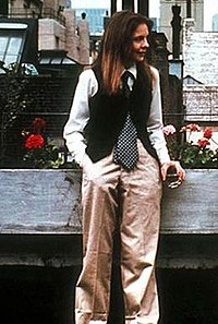 Image from the movie Annie Hall, a woman in pants and men's vest and tie