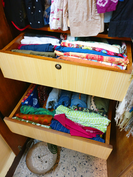 almira before Konmari Method with the drawers open