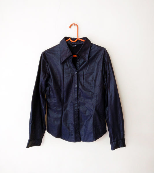 Image of artificial leather blouse to layer in the plane