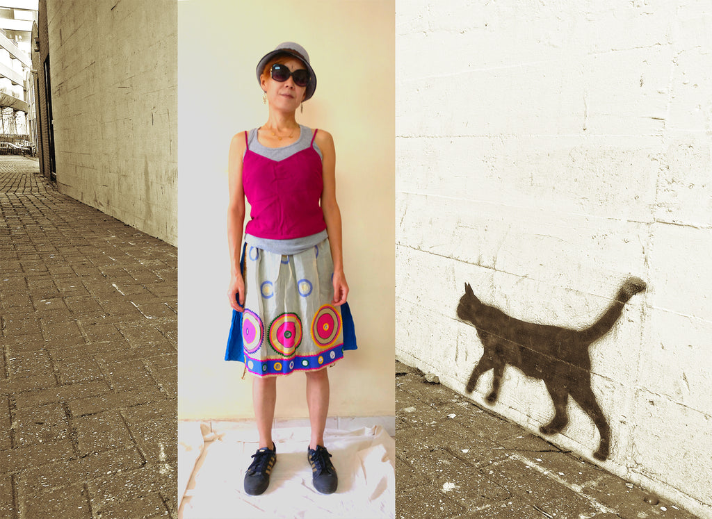 Styling idea of knee length tiered skirt - tanktop, camisole, and a hat
