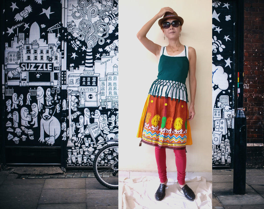 Styling idea of knee length tiered skirt - tanktop, fringed camisole, leggings, and a hat