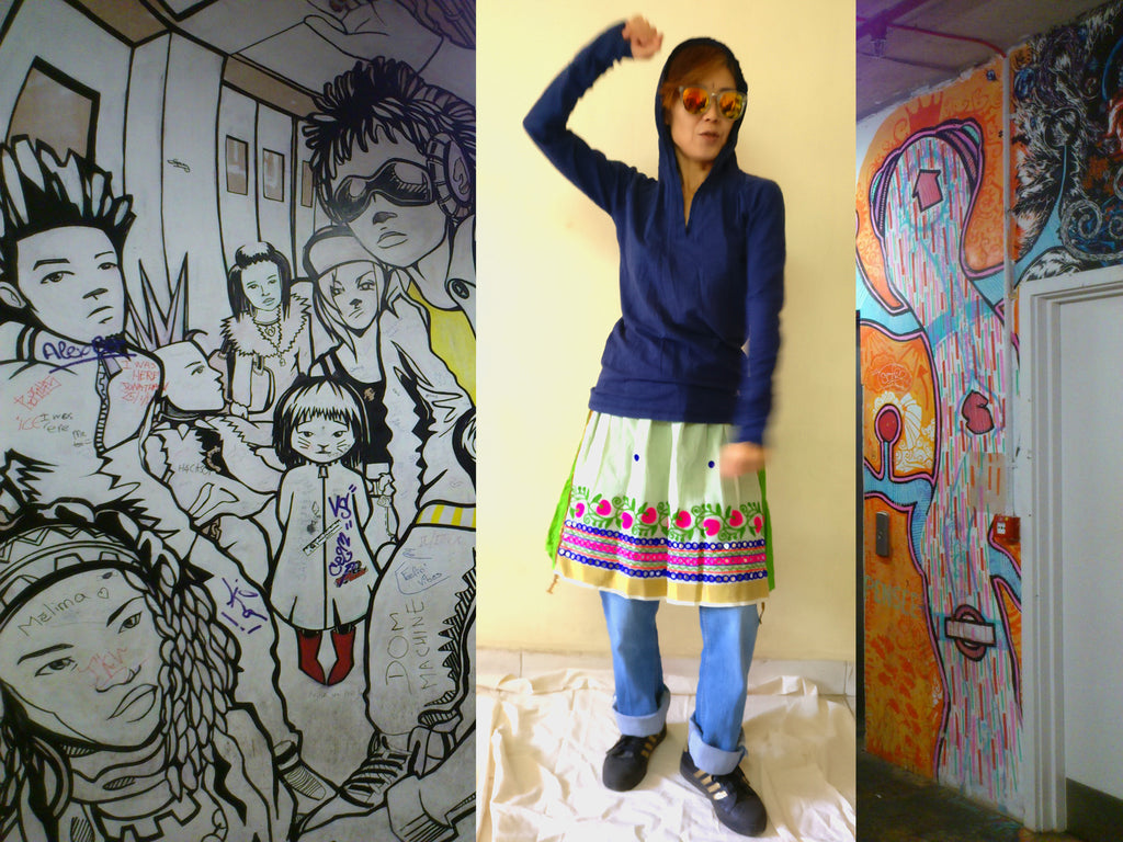 image of a styling idea with knee-length cotton handloom tiered skirt with hooded t-shirt and boyfriend jeans