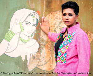 Image of Gowri Jayakumar in MIRCHI KOMACHI Pink Cotton Military Jacket in front of Pink Lady Resists mural