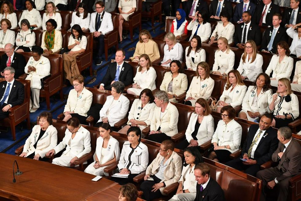 women members in white suits at administering oaths in 2019