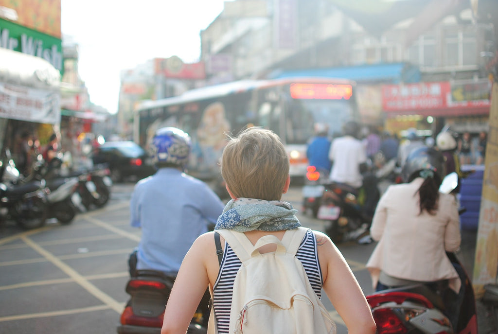 a female traveller in the street of a foreign country