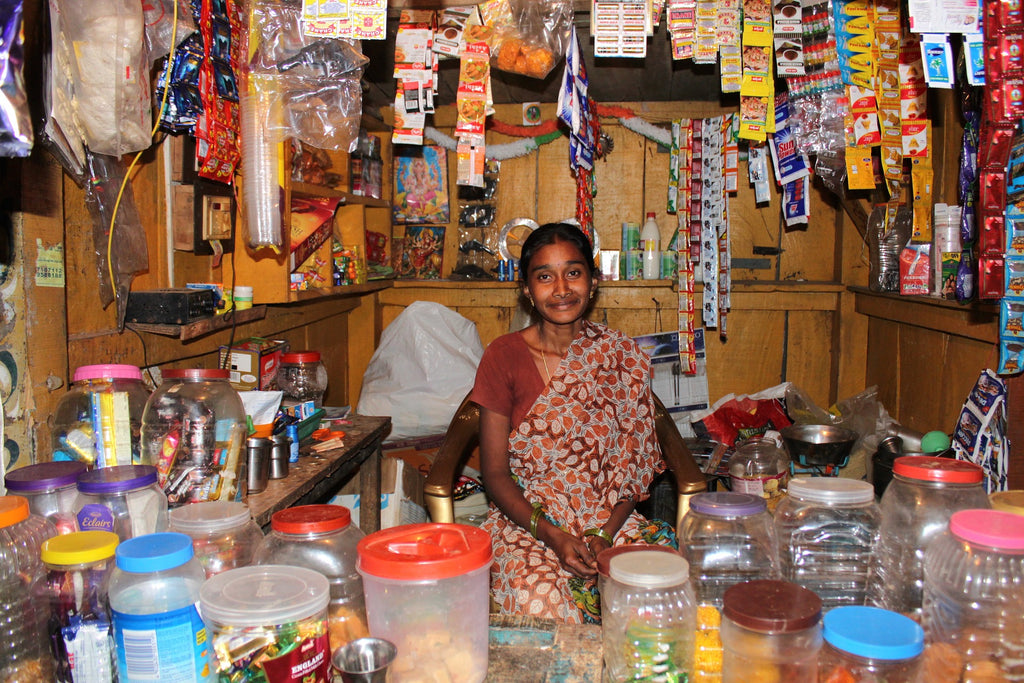 Image of a woman in a small general shop