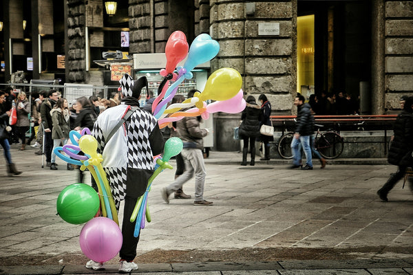 image of a clown selling baloons