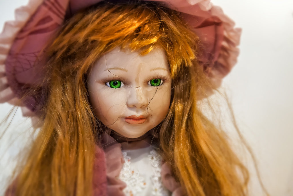 image of a girl doll with a cracked face