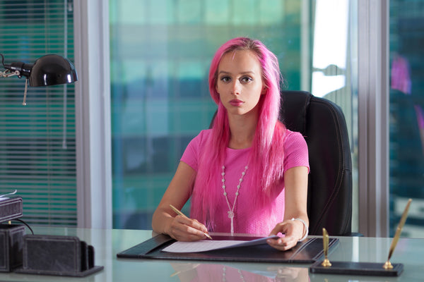 for 2nd post of MIRCHI KOMACHI blog _ a pink hair woman in a pink suit sitting in an office