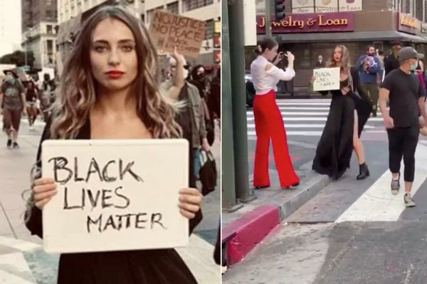 influencer or influenza taking pics with the BLM protesters as a background