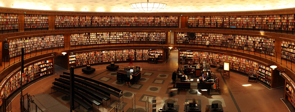 Image of a big library with full of books in the bookshelves