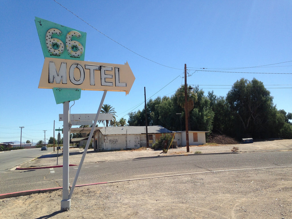 sign boards of motel and Route 66