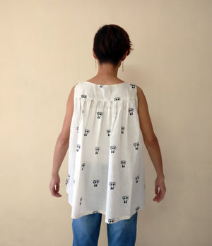 MIRCHI KOMACHI sleeveless cotton white pleated tunic is a very airy cute tunic.  Shop online!